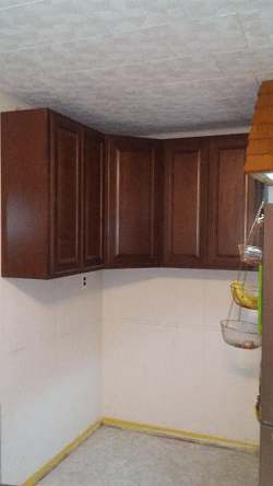 Wall cabinets installed in corner.
